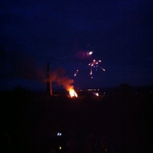The beacon with fireworks from a distant hill